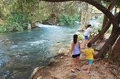 stock photo of israel people  - Sisters and Brother on the Jorden River  - JPG