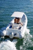 image of outboard engine  - A large white inflatible fishing boat powered by twin outboard engines cruising on the florida intercoastal near miami beach - JPG