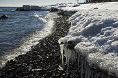 Icicles and snow on the shore of Lake Superior