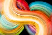 Colorful paper strips in motion photographed without digital manipulation