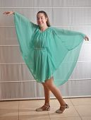 stock photo of sweet sixteen  - Young woman all dressed up in a teal dress for her Sweet Sixteen party - JPG