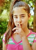 pic of shhh  - Portrait of a young Israeli girl - shushing shhh quiet