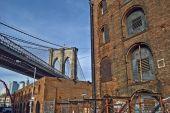 Brooklyn Bridge and brick buildings