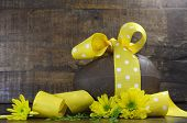 Happy Easter Chocolate Easter Egg With Yellow Polka Dot Ribbon And Spring Daisy Flowers Against A Da