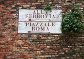 Directional sign to square on old Venetian building