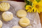 picture of shortbread  - Fresh baked melting moments shortbread biscuits with icing sugar straight from the oven - JPG