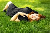 woman lies on grass
