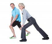 Happy Mature Couple Exercising