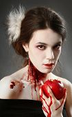 picture of gothic female  - Portrait of a female vampire over black background - JPG