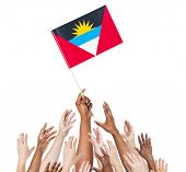 Multi-Ethnic Arms Raised for the Flag of Antigua and Barbuda