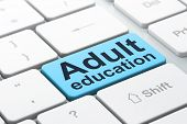 Education concept: Adult Education on computer keyboard background