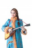 Charming Russian girl playing balalaika in studio