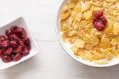 Bowl Of Milk With Corn Flakes Seasoned With Cranberries