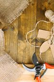 Working place of florist.Composition with sackcloth, pruner, twine and tags. Conceptual photo