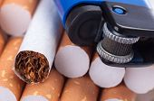 picture of cigarette lighter  - Tobacco in cigarettes and lighter close up - JPG