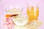 Homemade facial masks with natural ingredients, on color background