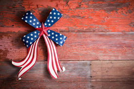 foto of emblem  - Indepedence Day 4th July emblem with a blue stars bow and curly red and white ribbon to celebrate the Declaration of Independence of the Untited States of America - JPG