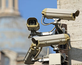 stock photo of wiretap  - four surveillance camera to see all main points of the great metropolis - JPG