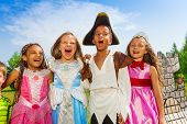 pic of singing  - Close up view of children in different festival costumes having fun together laughing or singing - JPG