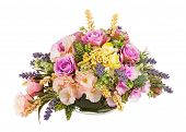 stock photo of centerpiece  - Bouquet from artificial flowers arrangement centerpiece in vase isolated on white background - JPG