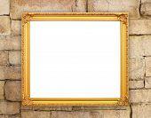 Blank Golden Frame On Brick Stone Wall