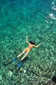 Woman Snorkeling In The Sea In Orange Bikini
