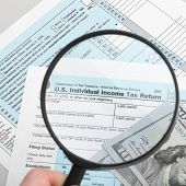 picture of cpa  - US Tax Form 1040 with magnifying glass and dollars - JPG