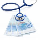 Euro Currency With Stethoscope Over It - Isolated On White