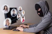 Masked Thief Stealing Data From Computers