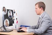 Social Network Concept - Young Business Man Working In Office