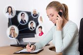 Social Network Concept - Businesswoman Talking On The Phone In Office