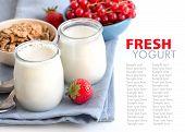 Jars Of Fresh Natural Yogurt, Berries And Muesli