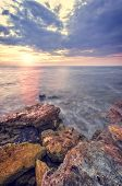 The Rocky Shore Of The Sea Illuminated By The Rays Of The Setting Sun