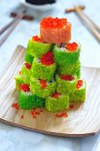 stock photo of avocado tree  - Maki Sushi Roll Christmas Tree on a table - JPG