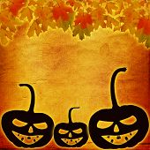 Festive Pumpkin Halloween Day On The Abstract Paper Background With Autumn Leaves
