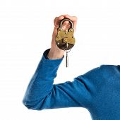 Redhead Man Holding Vintage Padlock Over White Background