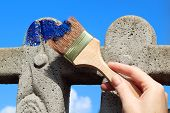 Painting Cement  Fence With Blue  Paint