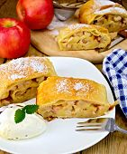 Strudel With Apples And Ice Cream With Napkin On Board