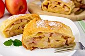 Strudel With Apples In Bowl On Linen Tablecloth