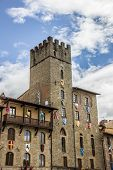 Tower With Flags And Shields At The Piazza Grande Of Arezzo