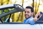 Young Black Latin American Driver Holding Car Keys Driving His New Car