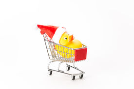 stock photo of caddy  - Caddy for shopping with christmas duck on white background - JPG