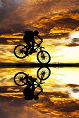 cyclist and red clouds