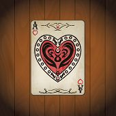 foto of ace spades  - Ace hearts poker cards old look varnished wood background - JPG