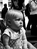 stock photo of storytime  - a one year old child watching a show in black and white - JPG