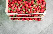 picture of grown up  - Home grown strawberries in a wooden basket  - JPG