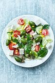 Mediterranean-style salad with whole green olives and feta cheese