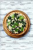 stock photo of baby goat  - Spinach pizza with goat cheese - JPG