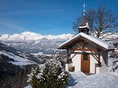 pic of mountain chain  - Mountain chapel in the Alps with Karwendel Mountains - JPG