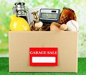 stock photo of yard sale  - Box of unwanted stuff ready for a garage sale - JPG
